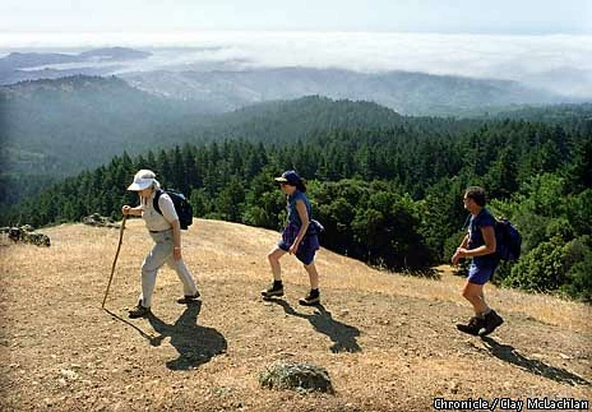 In this file photo, Susan Nelson (left) led park visitors on mountain hikes as a volunteer for the 220-member Mount Tamalpais Interpretive Association.