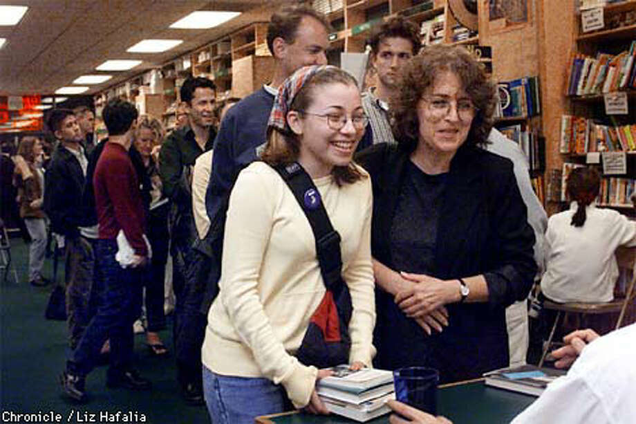 Alli Heller, 16, (left) and her mother Diane, from Phoenix, waited 45 minutes for best-selling author David Sedaris to sign their books after a recent reading at A Clean Well-Lighted Place for Books on Van Ness. Like other independently owned San Francisco bookstores, the store offers a variety of events for the literarily inclined.  Chronicle Photo by Liz Hafalia