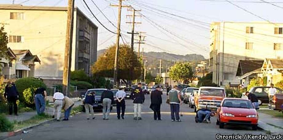 Police and FBI agents look for evidence on Thornton Street in San Leandro, near the Santos Linguisa Factory, where three government meat inspectors were shot and killed Wednesday afternoon. Chronicle photo by Kendra Luck / CHRONICLE
