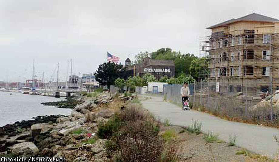 Getting access to Oakland's waterfront can be a challenge, here a pedestrian makes his way along the construction site of the Landing at Jack London Square, which when done in the spring of 2001 will be 282 luxury apartments just south of Jack London Square. Chronicle Photo by Kendra Luck