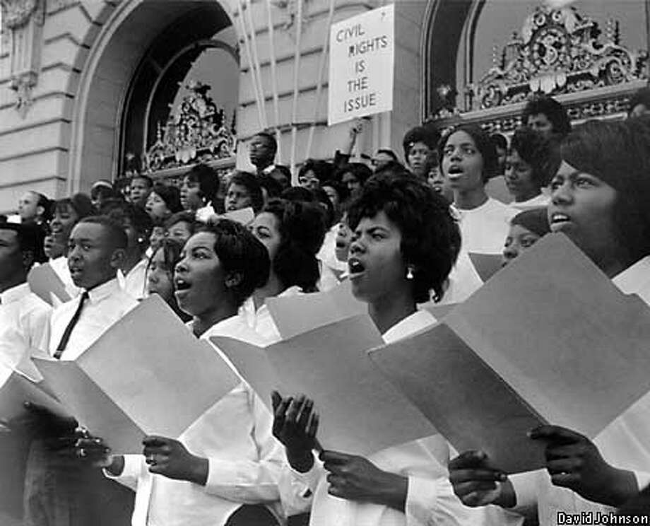 David Johnson's photograph of a youth choir in front of City Hall is one of the pictures on exhibit at Fort Mason and the Center for African and African American Art and Culture. / CHRONICLE