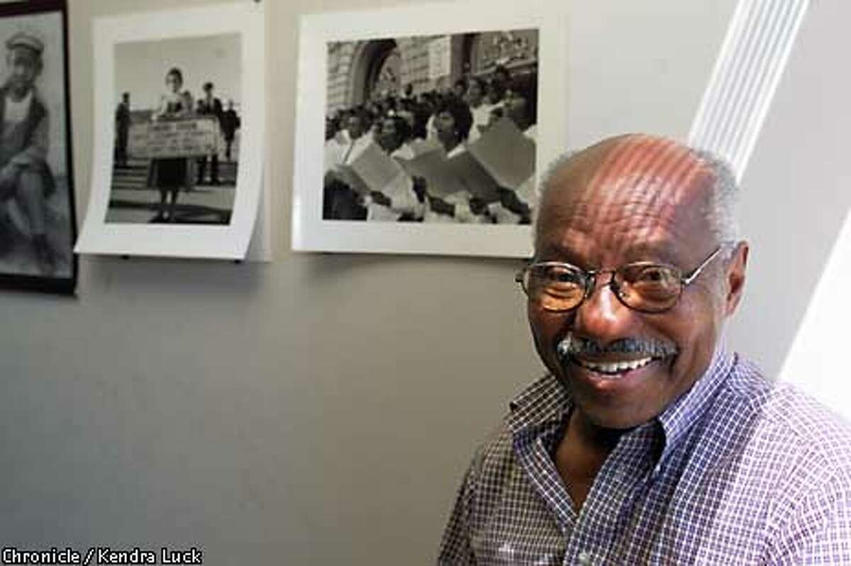 Johnson stood in front of some of his photos. Chronicle photo by Kendra Luck