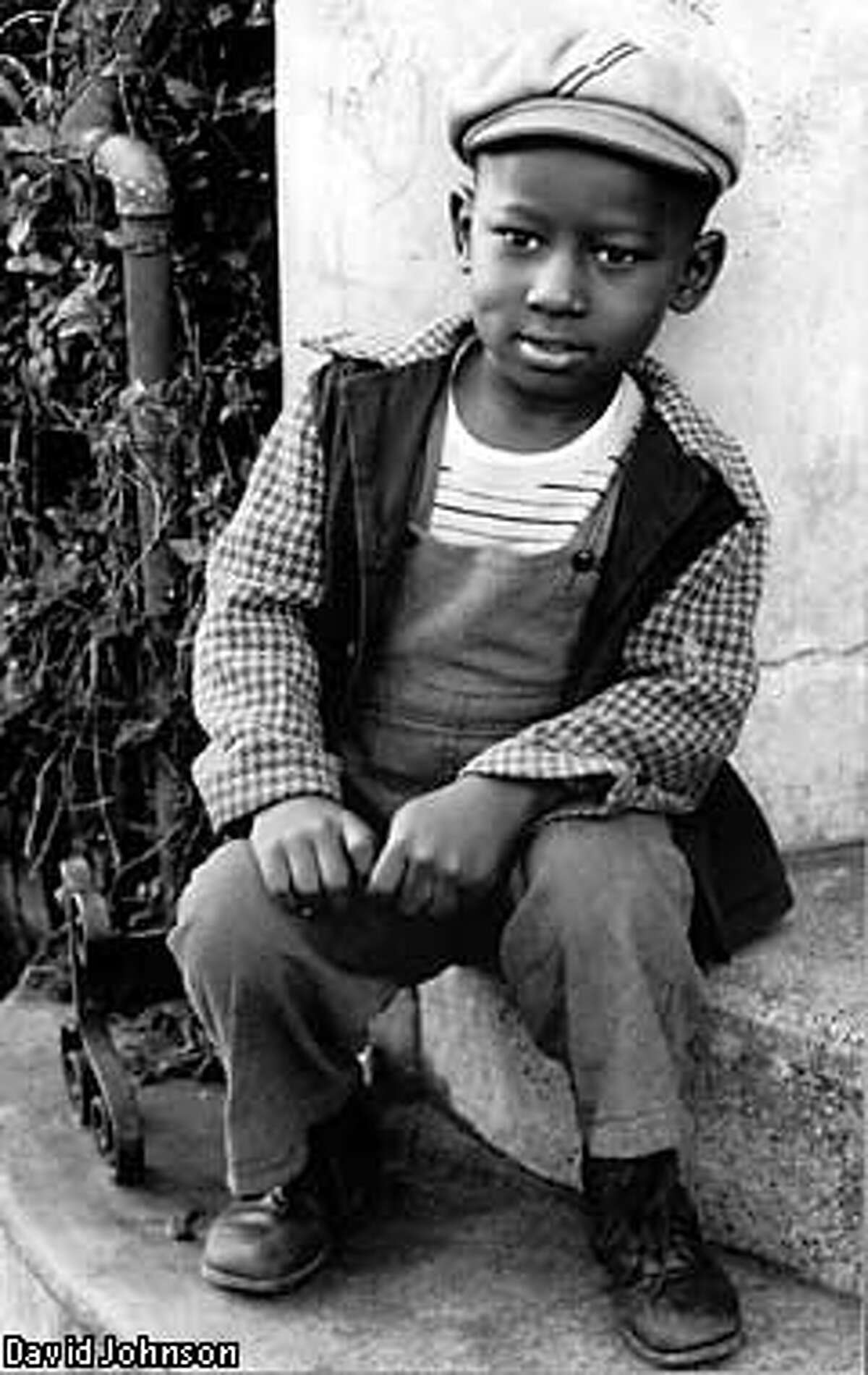 Clarence, a 5-year-old boy, sits on the steps of a church on O'Farrell Street in 1947. Photo courtesy David Johnson