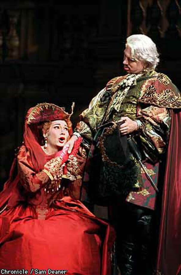 """Dmitri Hvorostovsky scowled his way through the title role of Mozart's """"Don Giovanni,'' but Carol Vaness brought life to the Opera production in the role of Donna Elvira. Chronicle photo by Sam Deaner"""