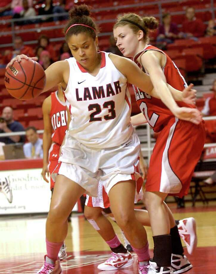 Lamar's Monique Whittaker drives around Nicholls' Jenny Nash at the Montange Center at Lamar University in Beaumont, Saturday, February 11, 2012. Tammy McKinley/The Enterprise Photo: TAMMY MCKINLEY