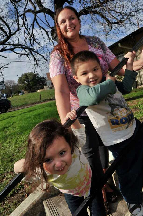Mary DeHoyos and her son Nicholas and granddaughter Krista Sanchez. DeHoyos received an email from the Patriots for Self-Deportation encouraging Americans to deport themselves if their ancestors entered the country illegally. Photo: Robin Jerstad, Photographs By Robin Jerstad/For The Express-New / Copyright 2012 by Robin Jerstad, Jerstad Photographics LLC, 210-254-6552, All Rights Reserved