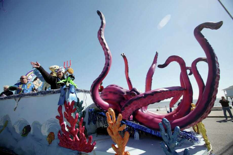 An oversized octopus decorates the lead float of the Mystic Krewe of Aquarius 25th Annual Mardi Gras Parade on Saturday, Feb. 11, 2012, in Galveston. The Mystic Krewe of Aquarius 25th Annual Mardi Gras Kick off Parade featured over 80 units including 20 high school marching bands. Photo: Mayra Beltran, Houston Chronicle / © 2012 Houston Chronicle