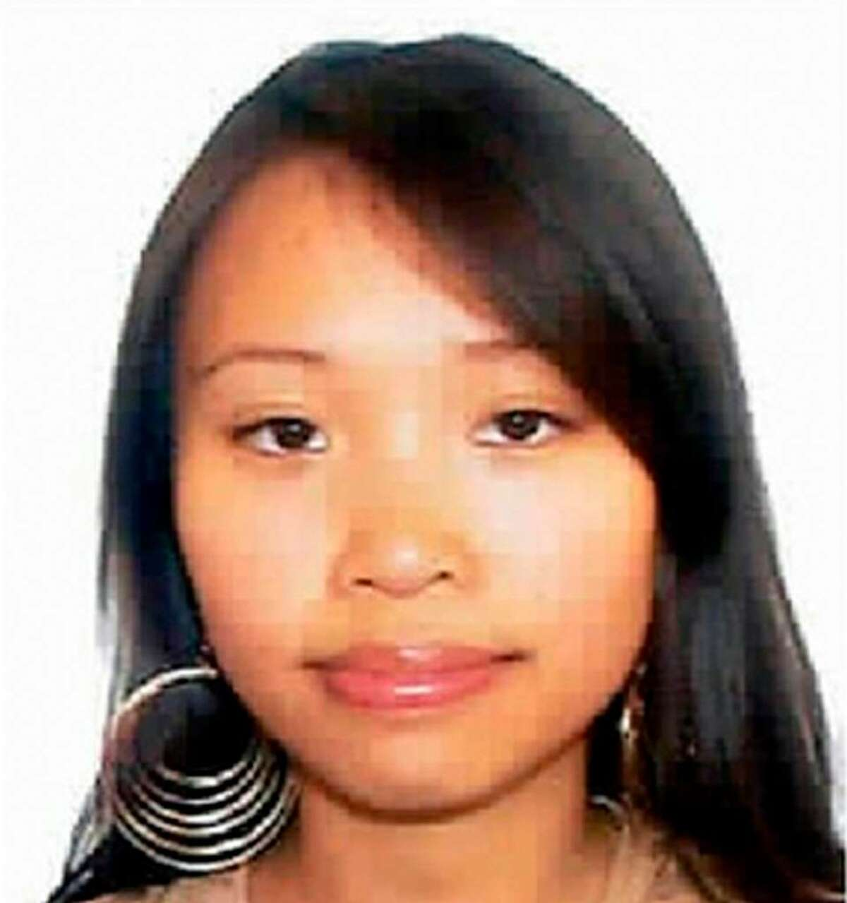 This composite photo release by New Haven Police Dept., shows Yale graduate student Annie Le in a video image entering 10 Amistad the morning of her disappearance on the campus at Yale University in new haven, Conn. Sept. 8, 2009. At left is an undated of Le. Police on Sunday said they found what they believe is the body of the graduate student and bride-to-be hidden inside the wall of 10 Amistad, a university building where she was last seen. (AP Photo/New Haven Police Dept.)