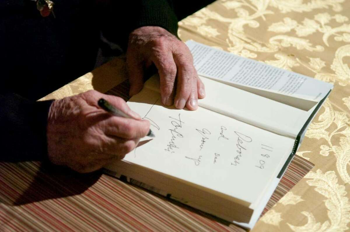 Tony Curtis autographs copies of his book during a fundraising event at the Avon Theatre Film Center in Stamford, Conn. on Sunday, Nov. 11, 2009.