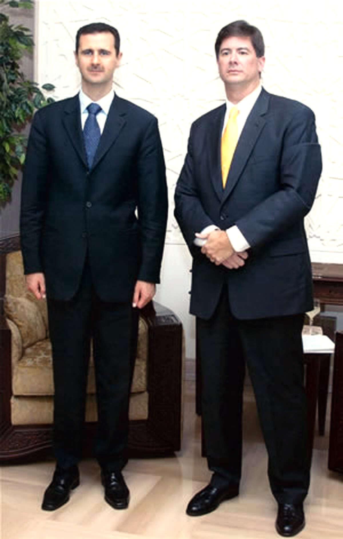 Syrian president Bashar al-Asad (left) meets with Trinity history professor David Lesch in Damascus.