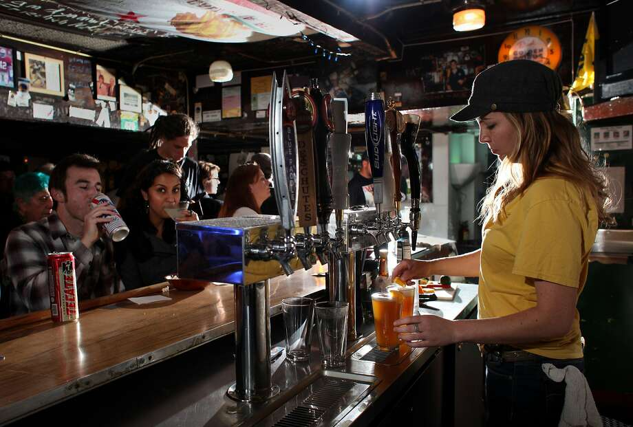 Bartender Jane Hurley serves customers at the old Kingfish bar, which is slowly making its way toward landmark status in Oakland. Photo: Lacy Atkins, The Chronicle