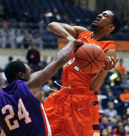 SPORTS   UTSA guard Melvin Johnson III is stopped on a fast break at the basket by Darius Gardner as the Roadrunners play the SFA Lumberjacks at the UTSA Convocation Center  on February 11, 2012 Tom Reel/ San Antonio Express-News Photo: TOM REEL, San Antonio Express-News / San Antonio Express-News