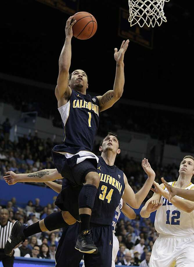 California 's Justin Cobbs, top, goes up for a basket as his teammate Robert Thurman and UCLA's David Wear, bottom left, look on during the first half of an NCAA college basketball game in Los Angeles, Saturday, Feb. 11, 2012. (AP Photo/Jae C. Hong) Photo: Jae C. Hong, Associated Press