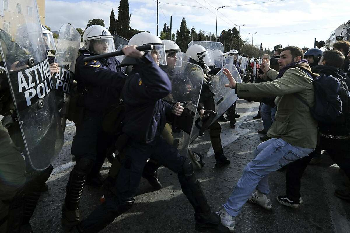 Police try to dispearse protestors from the front of the Greek parliament during the 48-hours anti-austerity strike on February 11, 2012. Protestors massed in Greece under heavy police watch Saturday after the government approved unpopular austerity cuts to get vital rescue funds and avoid the
