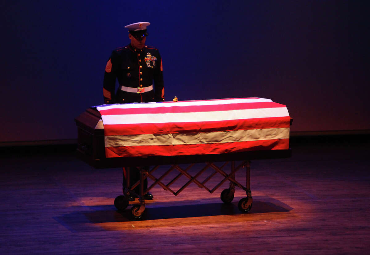 A Marine stands watch over the casket of Sgt. William Stacey of Seattle during his funeral on Saturday, February 11, 2012 at the University of Washington in Seattle. Stacey was killed on January 31st in Helmand Province, Afghanistan.
