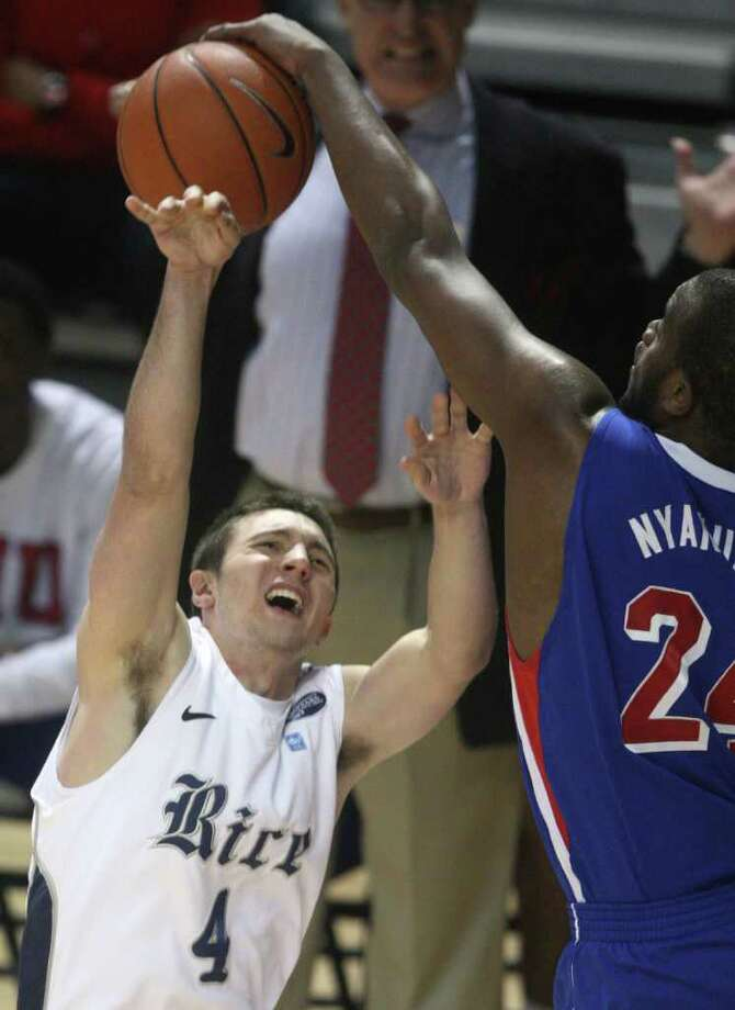 Rice guard Connor Frizzelle (4) is blocked by SMU forward Robert Nyakundi (24) during the first half of a NCAA college basketball game on Saturday, February 11, 2012 in Houston, TX. Photo: J. Patric Schneider, For The Chronicle / Houston Chronicle