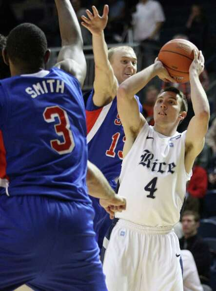 Rice guard Connor Frizzelle (4) puts up a shot over SMU guard Aliaksei Patsevich (13) and forward Le
