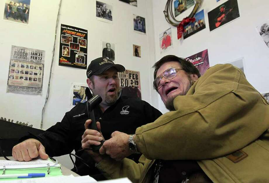 Radio personality Bruce Hathaway (right) interviews hunter Brian Quaca aka Pig Man at the 2012 San Antonio Stock Show & Rodeo on Saturday, Feb. 11, 2012. Quaca gained popularity through his television show which features him on various hunts especially bowhunting for hogs. Photo: Kin Man Hui, ~ / San Antonio Express-News