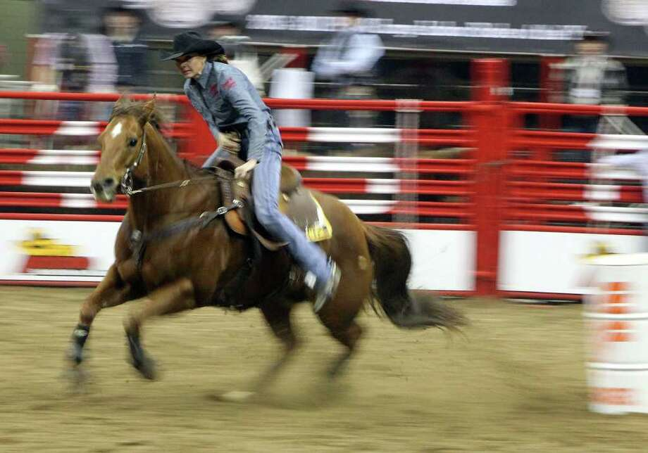 Kelli Tolbert competes in the barrel racing event at the 2012 San Antonio Stock Show & Rodeo on Saturday, Feb. 11, 2012. Photo: Kin Man Hui, ~ / San Antonio Express-News