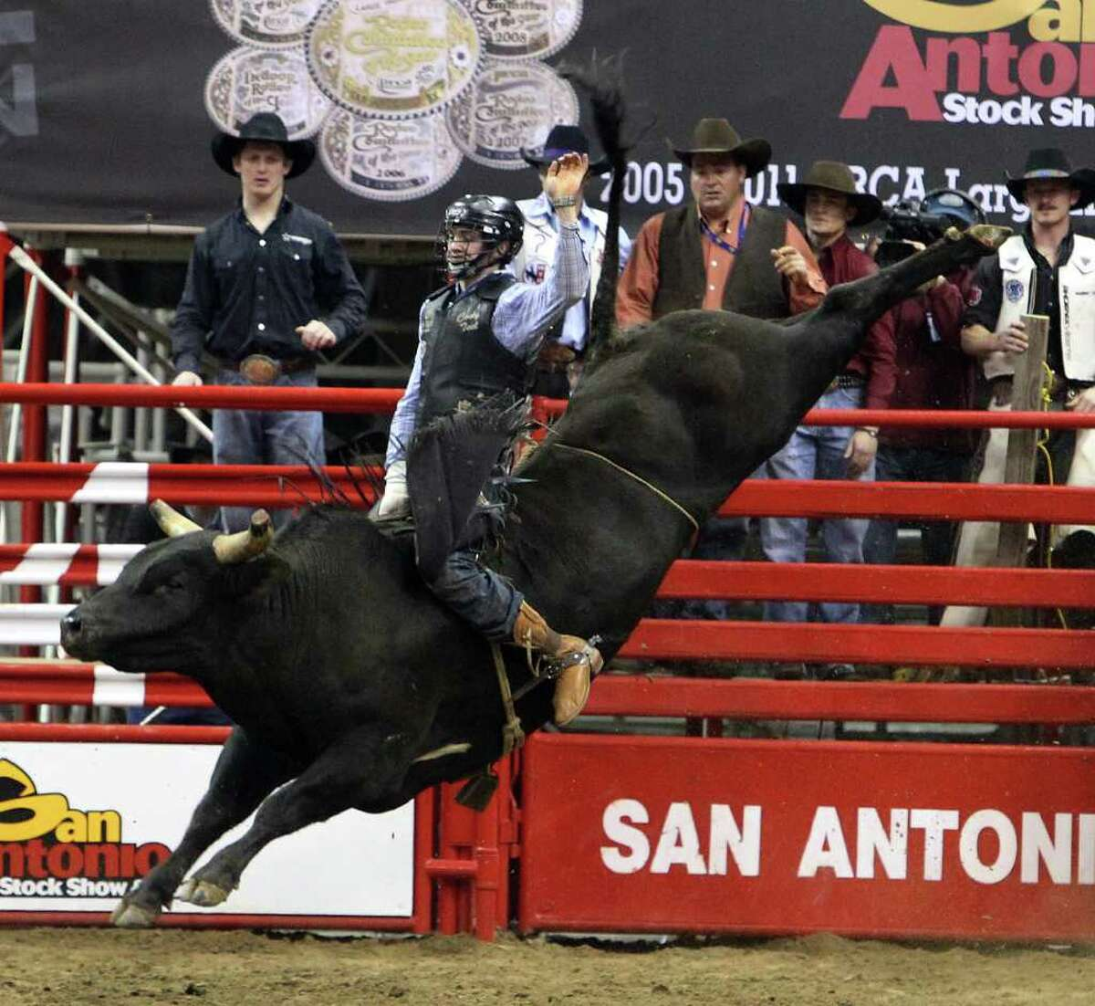 Cody Teel rides a bull named Black Dutch during the bull riding competition at the 2012 San Antonio Stock Show & Rodeo on Saturday, Feb. 11, 2012.