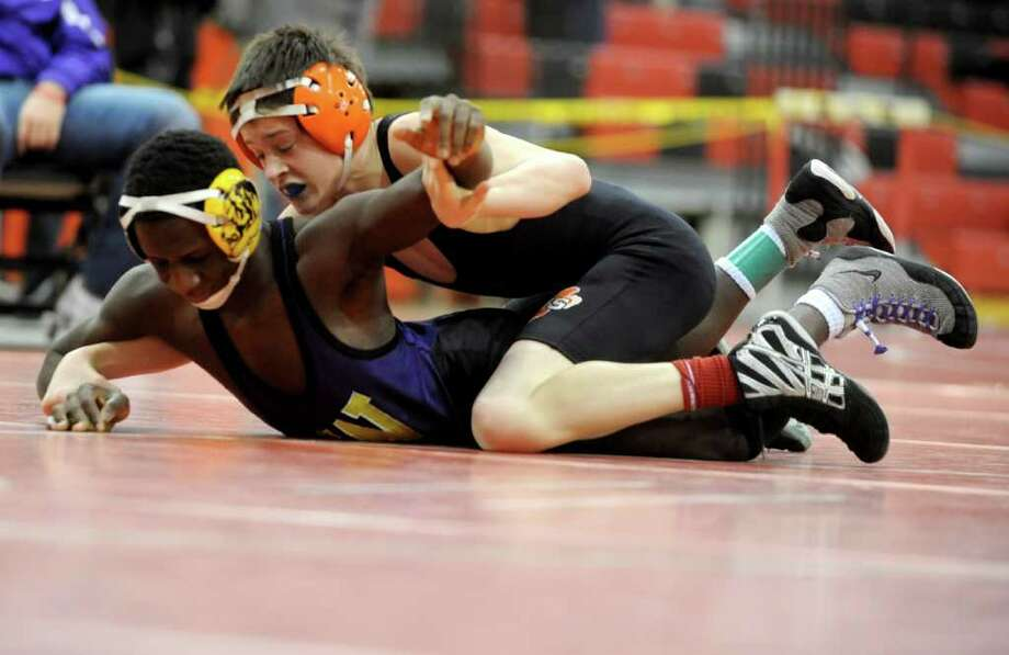 Kevin Side of Ridgefield wrestles against Pascal Medor of Westhill in the 106-pound weight class of the FCIAC wrestling semi-finals at New Canaan High School on Saturday, February 11, 2012. Photo: Lindsay Niegelberg / Stamford Advocate