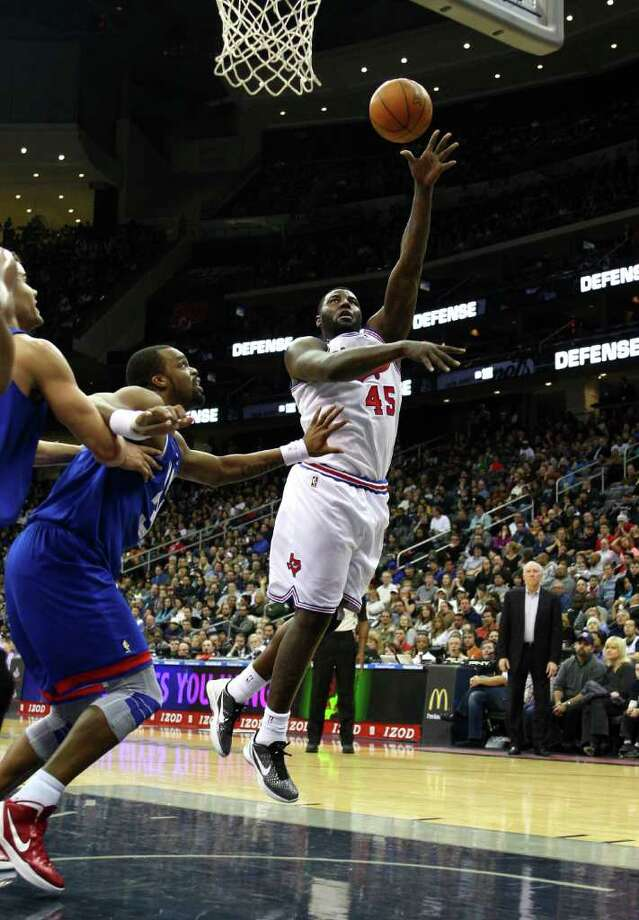NEWARK, NJ - FEBRUARY 11:  DeJuan Blair #45 of the San Antonio Spurs attempts a shot in the first half against Shelden Williams #33 of the New Jersey Nets at Prudential Center on February 11, 2012 in Newark, New Jersey.  NOTE TO USER: User expressly acknowledges and agrees that, by downloading and or using this photograph, User is consenting to the terms and conditions of the Getty Images License Agreement. Photo: Chris Chambers, Getty Images / 2012 Getty Images