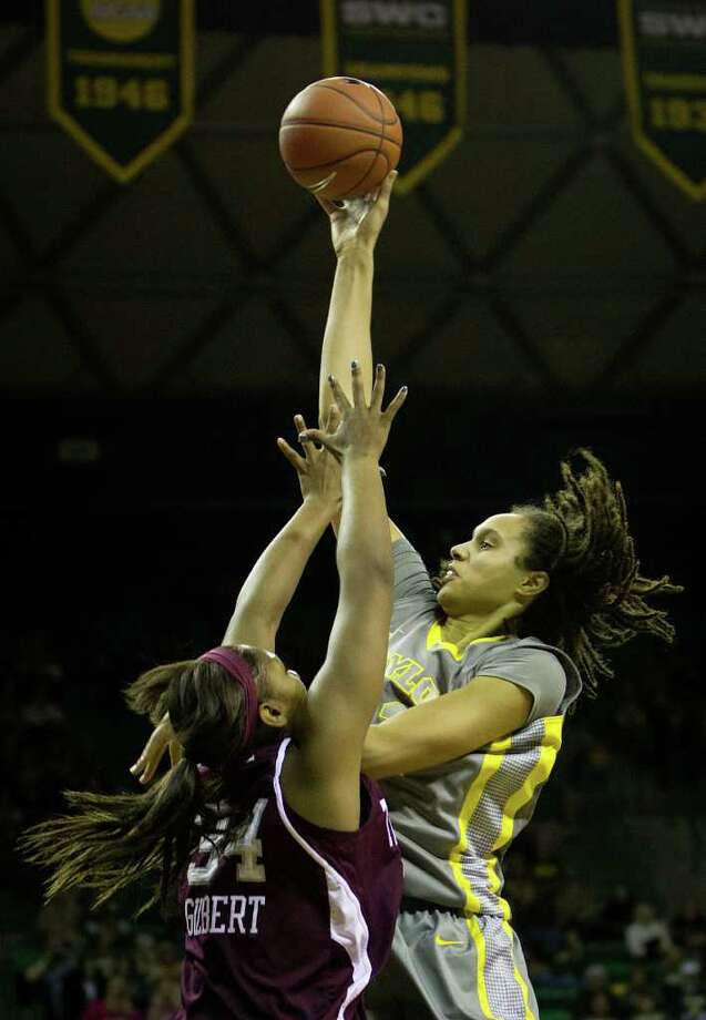 Baylor center Brittney Griner (42) rises above Texas A&M center Karla Gilbert like the Lady Bears are soaring above their competition on her way to a game-high 21 points. Griner added 10 rebounds, six blocks and plenty of intimidation. Photo: Smiley N. Pool / © 2012  Houston Chronicle