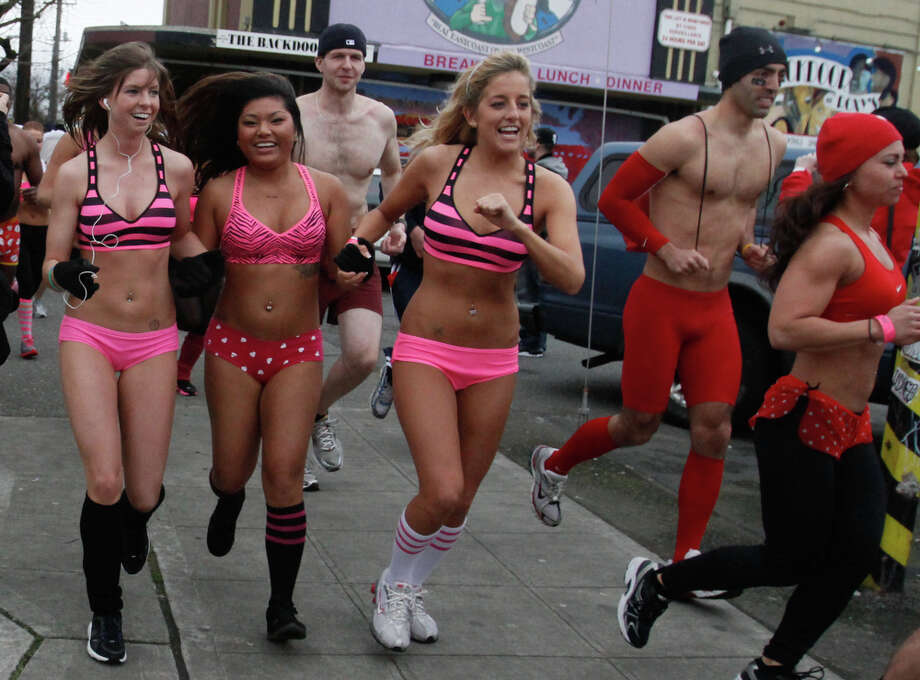 Cupid's Undie Run participants race around the Fremont neighborhood of Seattle on Saturday, Feb. 11, 2012. Proceeds from the event benefit the Children's Tumor Foundation. Photo: SOFIA JARAMILLO / SEATTLEPI.COM