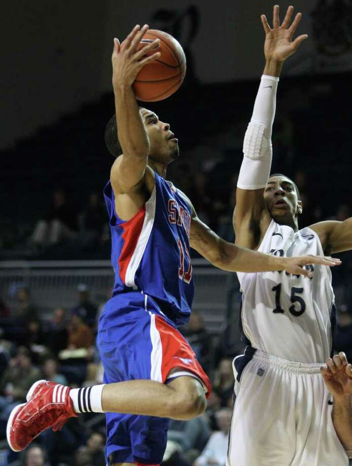 Rice guard Julian Debose (15) defends against SMU guard London Giles (11) during  the second half of a NCAA college basketball game at Tudor Fieldhouse on Saturday, February 11, 2012 in Houston, TX. Photo: J. Patric Schneider, For The Chronicle / Houston Chronicle