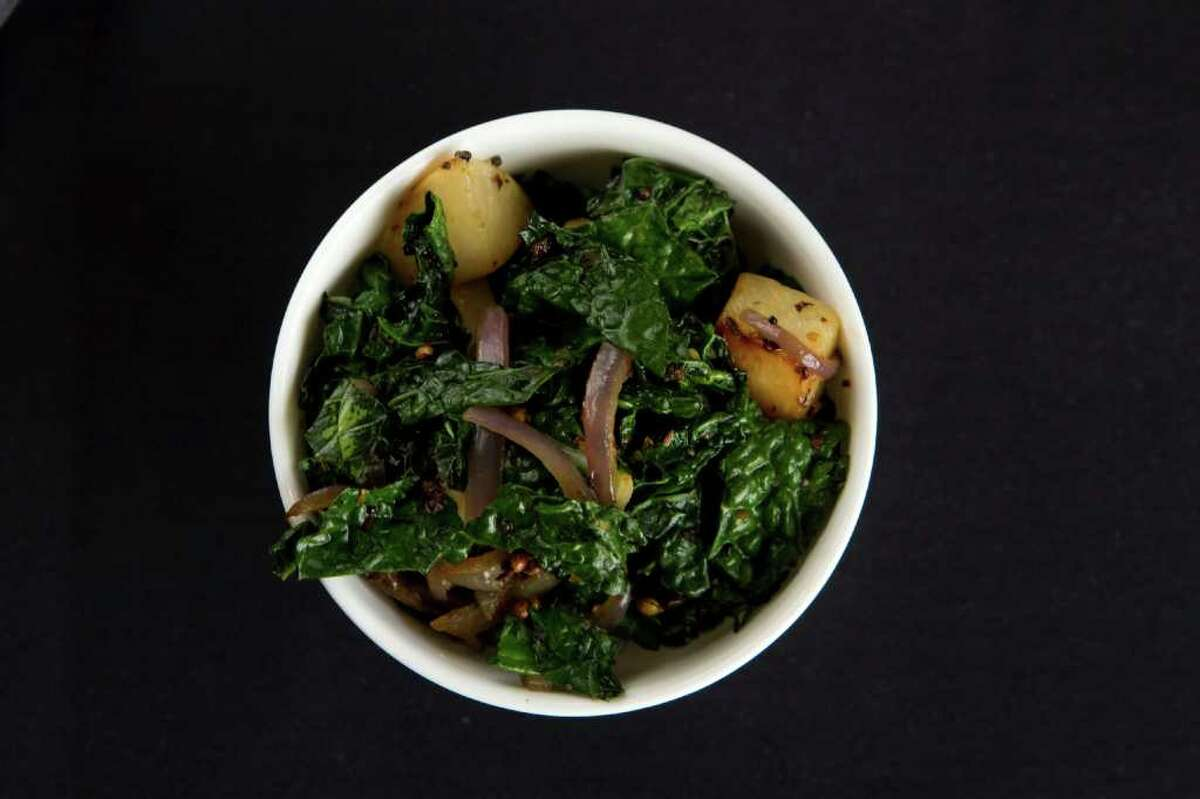 A bowl of turnips and kale, with red onions is shown at Kirin's Restaurant and Bar Friday, Feb. 10, 2012, in Houston. ( Brett Coomer / Houston Chronicle )