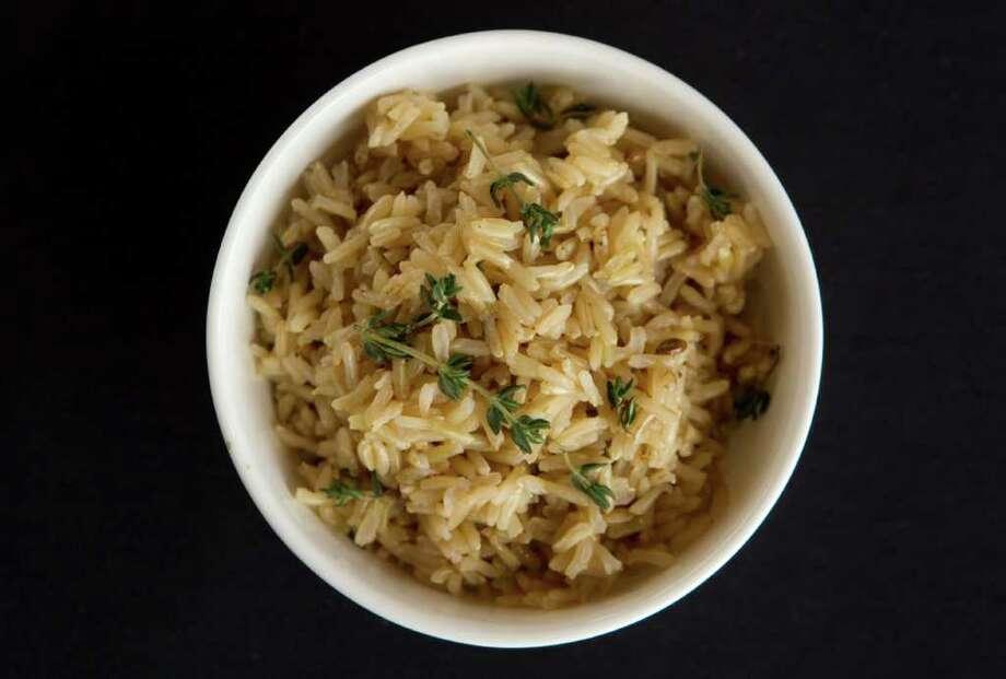 Rice is a staple in Persian cuisine. Varieties of rice in Iran include champa, rasmi, anbarbu, mowlai, sadri, khanjari, shekari and doodi.Iran vs. Nigeria: June 16 Photo: Brett Coomer / © 2012 Houston Chronicle