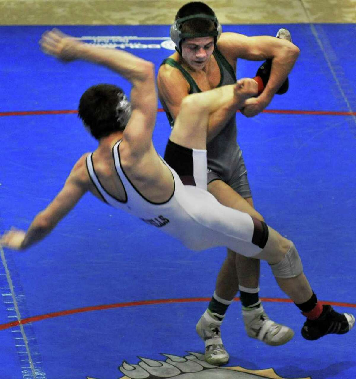 Shen's Nick Kelley up ends Burnt Hills' Joey Butler in the 132 lb. match in the finals for the Section II wrestling tournament at the Glens Falls Civic Center Saturday Feb. 11, 2012. (John Carl D'Annibale / Times Union)