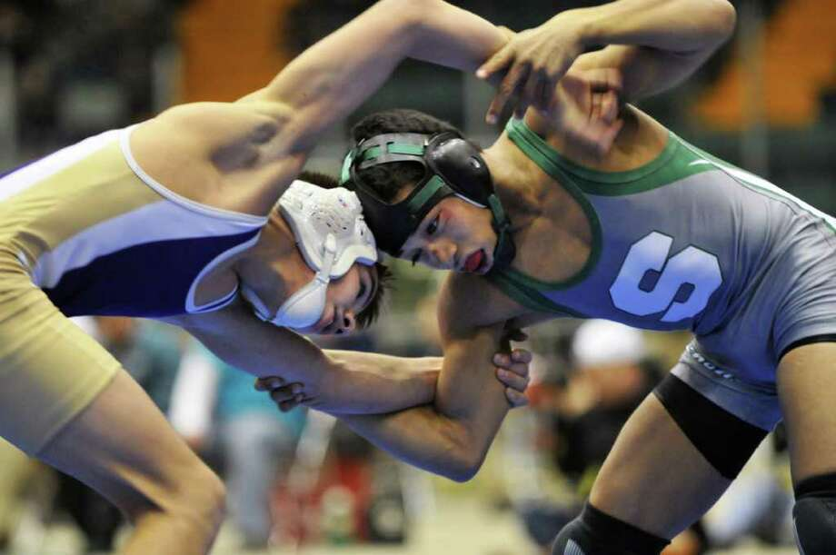 Amsterdam High's Brandon Lapi, left, andShen's Jesse Porter during the 113 lb. match in the finals for the Section II wrestling tournament at the Glens Falls Civic Center Saturday Feb. 11, 2012.   (John Carl D'Annibale / Times Union) Photo: John Carl D'Annibale / 00016192B