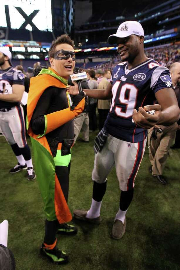 "INDIANAPOLIS, IN - JANUARY 31:  A member of the media dressed as a super hero and representing ""Nicktoons"" interviews Markell Carter #49 of the New England Patriots during Media Day ahead of Super Bowl XLVI against the New York Giants at Lucas Oil Stadium on January 31, 2012 in Indianapolis, Indiana.  (Photo by Andy Lyons/Getty Images) *** Local Caption *** Markell Carter Photo: Andy Lyons / 2012 Getty Images"