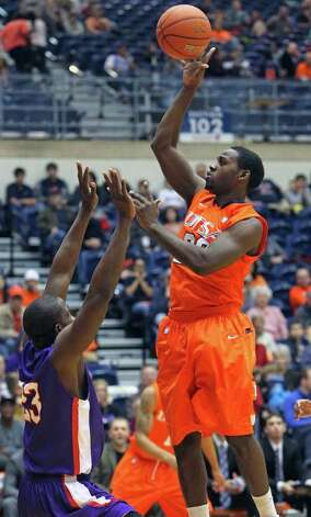 UTSA guard Kannon Burrage cranks up a floater on the run as the Roadrunners play the SFA Lumberjacks at the UTSA Convocation Center  on February 11, 2012 Tom Reel/ San Antonio Express-News Photo: TOM REEL, Express-News / San Antonio Express-News