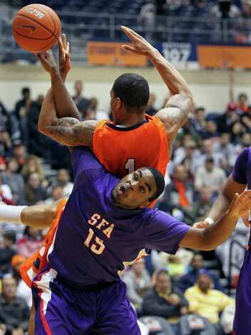 SFA's Joe Bright moves under the rebounding effort of Stephen Franklin and is called for a position foul as the Roadrunners play the SFA Lumberjacks at the UTSA Convocation Center  on February 11, 2012 Tom Reel/ San Antonio Express-News Photo: TOM REEL, Express-News / San Antonio Express-News