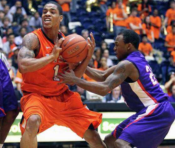 UTSA forward Stephen Franklin draws flak in the lane as Darius Gardner moves in to stop him as the Roadrunners play the SFA Lumberjacks at the UTSA Convocation Center  on February 11, 2012 Tom Reel/ San Antonio Express-News Photo: TOM REEL, Express-News / San Antonio Express-News