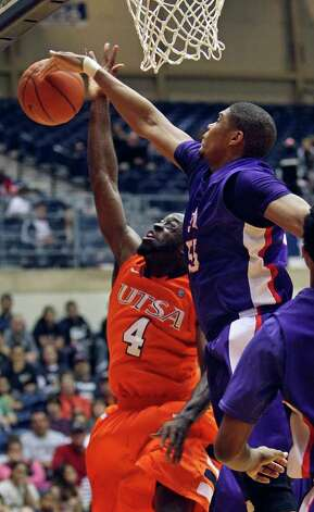 SFA center Jereal Scott helps thwart a late comeback by UTSA by blocking a layup attempt by Sei Paye as the Roadrunners play the SFA Lumberjacks at the UTSA Convocation Center  on February 11, 2012 Tom Reel/ San Antonio Express-News Photo: TOM REEL, Express-News / San Antonio Express-News