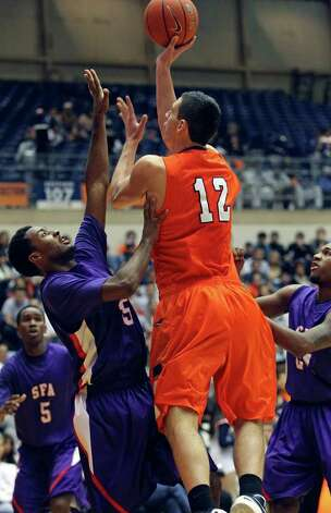 UTSA forward Jeromie Hill puts up a shot over Desmond Haymond as the Roadrunners play the SFA Lumberjacks at the UTSA Convocation Center  on February 11, 2012 Tom Reel/ San Antonio Express-News Photo: TOM REEL, Express-News / San Antonio Express-News