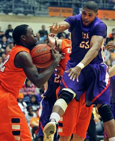 UTSA's Kannon Burrage pulls a rebound away from Jereal Scott as the Roadrunners play the SFA Lumberjacks at the UTSA Convocation Center  on February 11, 2012 Tom Reel/ San Antonio Express-News Photo: TOM REEL, Express-News / San Antonio Express-News