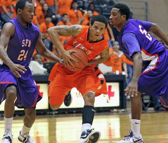 UTSA point guard Michael Hale III breaks through pressure from Darius Gardner (24) and Desmond Haymond as the Roadrunners play the SFA Lumberjacks at the UTSA Convocation Center  on February 11, 2012 Tom Reel/ San Antonio Express-News Photo: TOM REEL, Express-News / San Antonio Express-News
