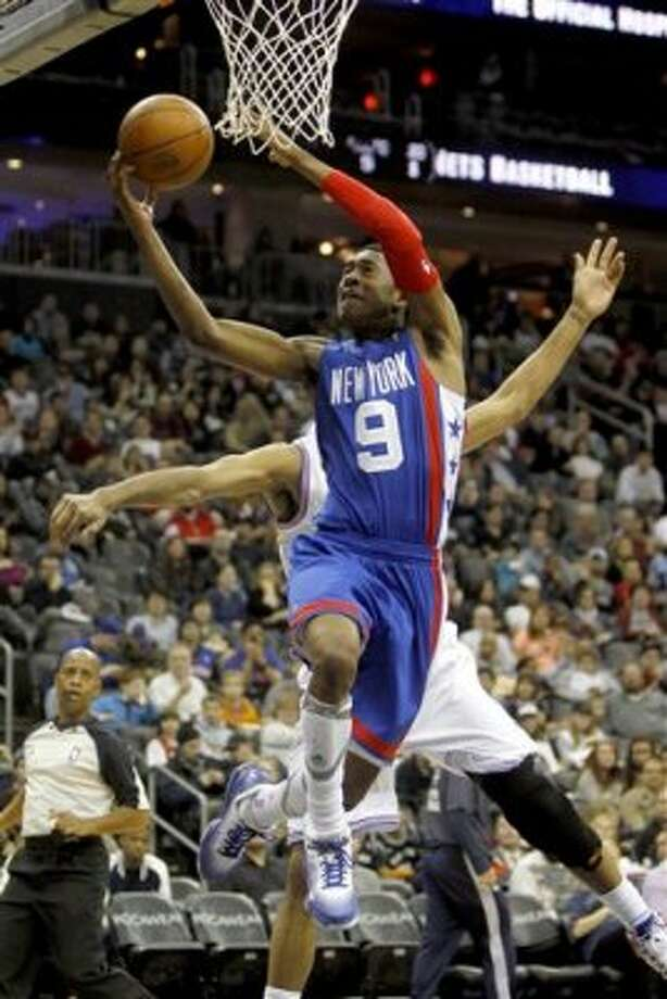 New Jersey Nets' MarShon Brooks (9) shoots a layup against the San Antonio Spurs in the first half of an NBA basketball game in Newark, N.J., Saturday, Feb. 11, 2012. (AP Photo/Rich Schultz) (AP)