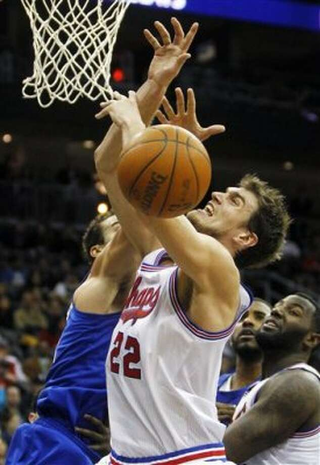 San Antonio Spurs' Tiago Splitter (22), of Brazil, loses the ball as New Jersey Nets' Kris Humphries (43) defends in the second half of an NBA basketball game in Newark, N.J., Saturday, Feb. 11, 2012. The Spurs won 103-89. (AP Photo/Rich Schultz) (AP)