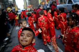 Students of the Stonebrae Elementary School Mandarin Immersion Program in Hayward dance around at the Chinese New Year parade in San Francisco, Calif., Saturday, February 11, 2012.