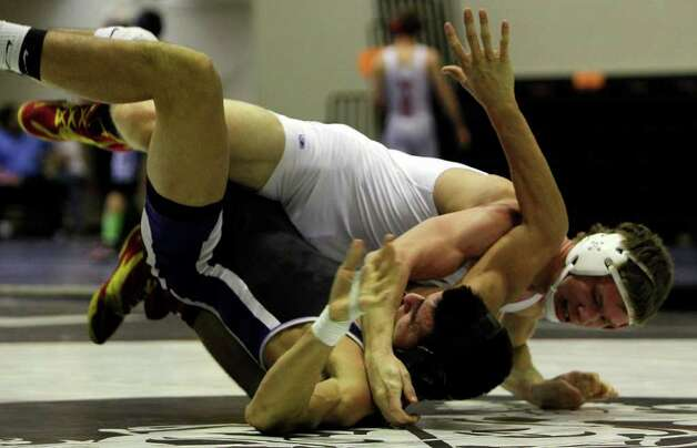 Judson's Dominic Zaleski slams Eli Urbina of Weslaco East High School during the boys' finals of the Region IV wrestling tournament at Littleton Gymnasium on Saturday, Feb. 11, 2012. Urbina won to become the 182 lb. champion. MICHAEL MILLER / mmiller@express-news.net Photo: Michael Miller, Express-News / © 2012 San Antonio Express-News