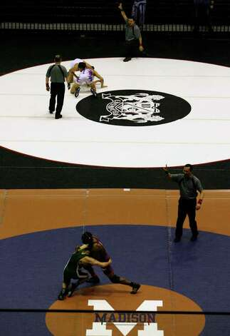 Wrestlers compete during the boys' finals of the Region IV wrestling tournament at Littleton Gymnasium on Saturday, Feb. 11, 2012. Austin Bowie won the tournament with 151 points. MICHAEL MILLER / mmiller@express-news.net Photo: Michael Miller, Express-News / © 2012 San Antonio Express-News