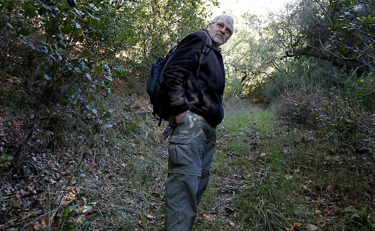 Rodney Jackson Ph.D. walks on a trail he has set up remote cameras on near Glen Ellen, in Sonoma County. Rodney Jackson Ph.D., the world's foremost expert on snow leopards, uses remote camera traps to record the elusive cats in Asia. He uses the same technology near his Sonoma home to watch for mountain lions, bobcats, fox and other beasts.