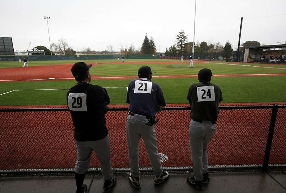 Baseball hopefuls wait for their turn during tryouts for the San Rafael Pacifics in Oakland, Calif., Sunday, January 22, 2012.  The Pacifics are a new independent team in the North American Baseball League. Photo: Sarah Rice, Special To The Chronicle