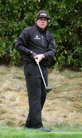 Phil Mickelson watches his drive on the sixteenth hole at Pebble Beach Golf Links during the third round of the AT&T Pebble Beach National Pro-Am golf tournament in Pebble Beach, Calif., Saturday, February 11, 2012. Photo: Lance Iversen, The Chronicle