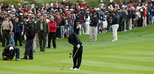 Tiger Woods lhits his third shot on the eighteenth hole during the third round of the AT&T Pebble Beach National Pro-Am golf tournament in Pebble Beach, Calif., Saturday, February 11, 2012. Photo: Lance Iversen, The Chronicle